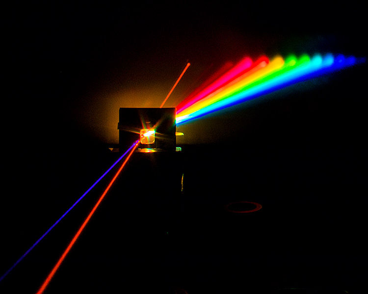 A multiplexing stream: The beams from three laser pointers of different wavelengths pass through a tank of water, and exit into a single water stream