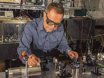 Dave Howe of NIST with laser equipment