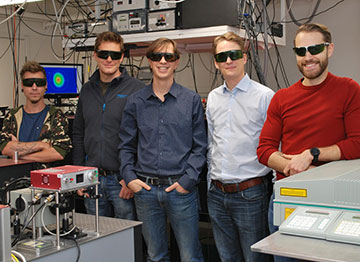 Five scientists in the lab