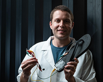man holding electrically connected flip-flop