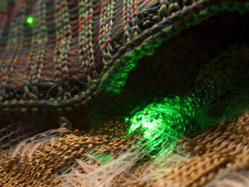 photo of fabric with green light-emitting spots