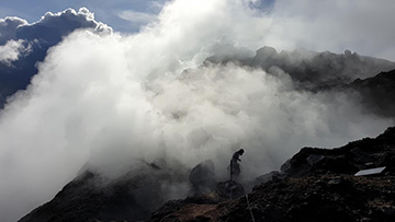 photo of researcher at fumarole site