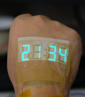 photo of hand with stretchable stopwatch display